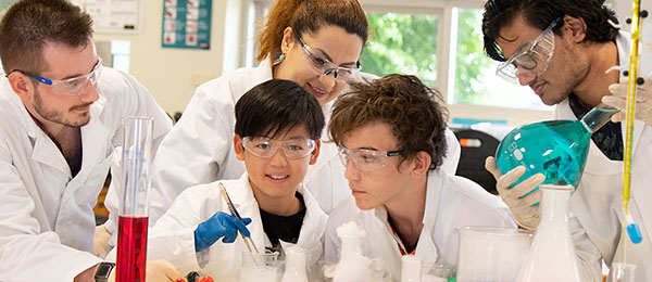 Charles Darwin University 2020 Chemistry Spectacular team from left, Daniel Brummit, Finn Wang, Elanz Saki, Sam Doyle and Syed Mahood steaming up a cloud of colour in the laboratory at CDU.
