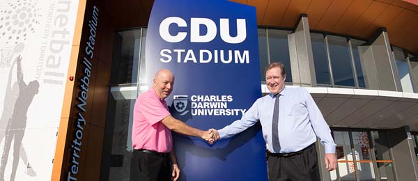 Netball NT Executive Officer Ian Harkness and CDU Deputy Vice-Chancellor Global Strategy and Advancement Andrew Everett celebrate the partnership between the two organisations