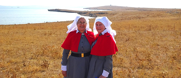 CDU Nursing Museum curator Janie Mason (left) and Julie Lloyd at the 2015 re-enactment of the arrival of the Anzac nurses at Lemnos Island