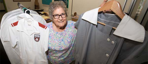 Curator of the Nursing Museum Janie Mason with some historic NT nursing uniforms