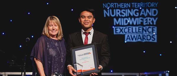 CDU Nursing graduate, Janry Ballesteros has been recognised as this year's NT New to Practice Nurse / Midwife of the Year. He is pictured with Dean of the College of Nursing and Midwifery Professor Catherine Turner