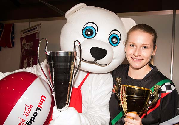 CDU student Larrissa Rawn, representing the Casuarina Football Club, shares a moment with the UniLodge bear