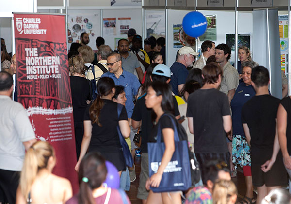 Crowds stroll through dozens of stalls showcasing Higher Education and VET courses