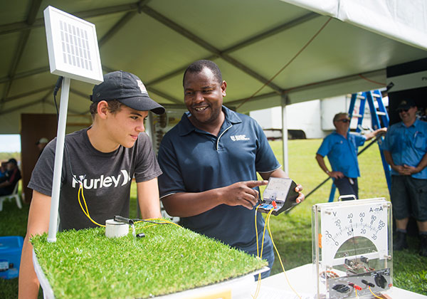 Ben Curries observes a miniature solar irrigation pump with electrotechnology lecturer George Chingwangwe