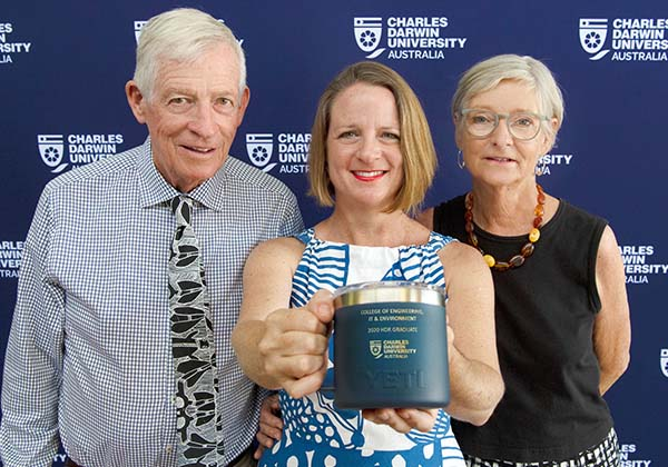 PhD graduate Pia Harkness (centre) with dad Col and mum Eva