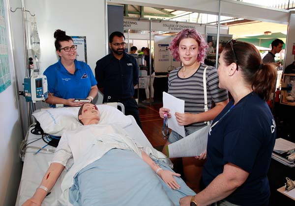 Francesca Gherdevich (second from right) speaks with Nursing and Midwifery staff
