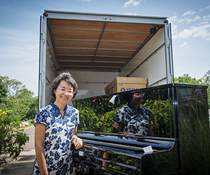 CYCM Acting Director Chen Hui oversees the arrival of the new polished ebony pianos