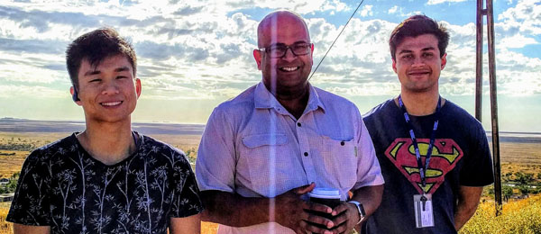 Pharmacy students Brandon Lim (left) and Omar Khan, pictured with mentor Rohan Rasiah, have returned from their remote placements in the Pilbara