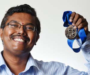 """Senior Lecturer in Clinical Sciences Dr Rama Jayaraj with his 2015 Pride of Australia """"Inspiration Medal"""" for the NT. Photo courtesy NT News"""