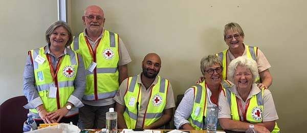 CDU Humanitarian and Community Studies student Gunveer Mann (seated centre) gained invaluable experience working with the Red Cross following the Townsville floods