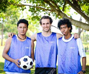 Jiwan Gajmer, Pat Sim and Bertanizo Guro are training together to participate in the Football Cup
