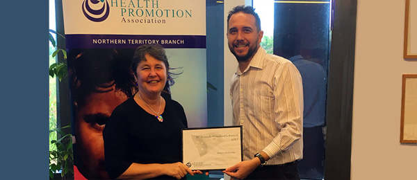 Robyn Williams receives the President's Awards from associate professor James Smith