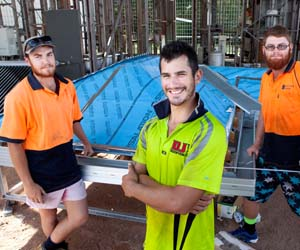Third year apprentices Sharali Mahomet, Jason Holtham (front) and Daniel De Palma construct a mock-up roof on campus