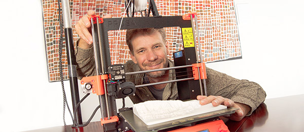 CDU Researcher Rohan Fisher with the 3D printing technology