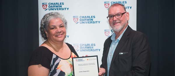 Certificate IV in Community Services Linda Zaborskis receives her scholarship from Minister for Education Peter Chandler