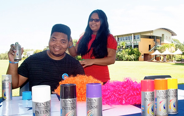 Nqabezwe Ngwabi goes under the spray can. Pictured with Lara Terte