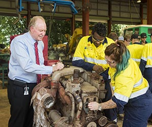 Training Minister Peter Styles meets apprentice mechanics Darren Wauchope and Kayla Williams in the automotive workshop