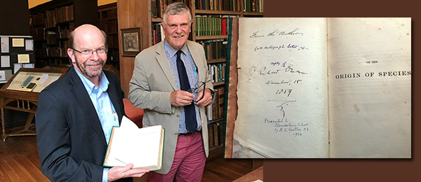 """Vice-Chancellor Professor Simon Maddocks and the Archivist of the Ancient Taylor Library at Shrewsbury School, Dr Robin Brooke-Smith. AT RIGHT: The first edition of """"On the Origin of Species"""", published 1859 and held by the library"""