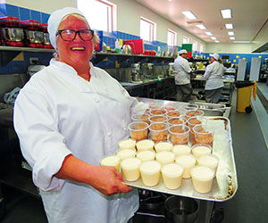 Pat Skinner with the latest batch of desserts … panna cotta Bavarian creams and chocolate mousses
