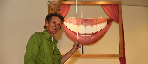 Henry Smith and his latest kinetic sculpture share a smile with the world