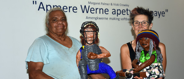 Margaret Palmer and Vicki Crowley with two of the sculptures: a player and one of the spectators