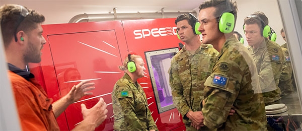 Australian Army soldiers check out the 3D printing technology