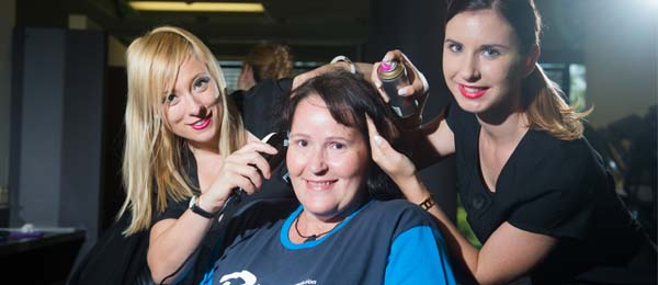 CDU hairdressing lecturer Jo-anne Summerhill, Customer Service Operator Theresa Fillmore (centre) and Certificate III in Hairdressing student Roxanne Fletcher
