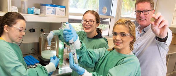Medical Laboratory Science students Giselle Dabbs, Ashley Alford and Jessica Adams with Foodbank NT CEO Peter Pilt