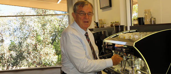 His Honour John Hardy OAM inspects one of the new coffee making machines