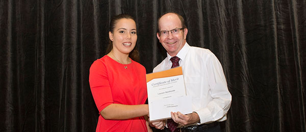 Lauren Northcote accepts the Top ATAR certificate from Vice-Chancellor Professor Simon Maddocks