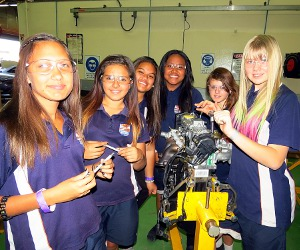 Centralian Middle School students Cassie Boyle, Hayley Baliva, Precious Palupe, Luisa Mulitalo, Donna Peace and Rachel Knott dismantle a four-cylinder engine at Try'a Skill in Alice Springs