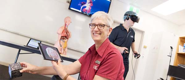 Nursing lecturer Ann Bolton shows some of the technology used by students