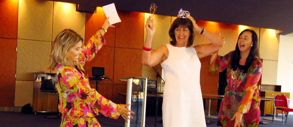 Celine Ociones (left) and Jade Hatt (right) perform a song and dance routine to farewell Lorna Walker
