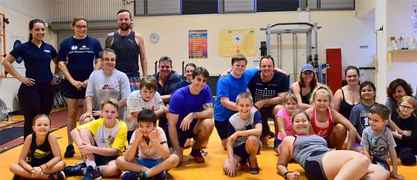 Coaches, parents and participants at the Introductory Olympic Weightlifting Junior Program