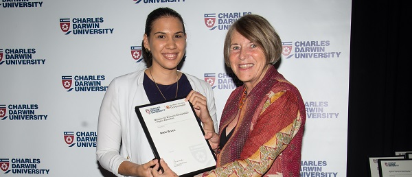 Deputy Vice-Chancellor Professor Sharon Bell presents Rikki Bruce with the scholarship in 2015
