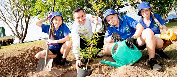 Durack Primary School students Madalyn Duncan (left), Rhys Trenbath, Jakobi Davies were joined by CDU's Pro Vice-Chancellor Student Engagement and Success, Professor Philip Seltsikas to mark National Tree Day