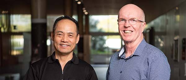 Chinese scholar Yaru Liu (left) joins the CDU Confucius Institute as Deputy Director and works with Director Professor David Young (right) to advance Chinese education in the NT.