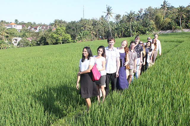 Universitats Udayana Law Faculty Lecturer Putu Aras Samsithawrati and the CDU group in a subak-system rice field in Tabannan, Bali