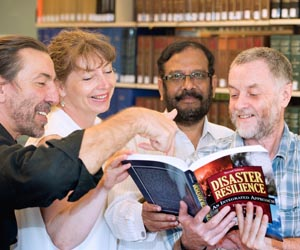 "(From left) Associate Professor Ioannis Michaloudis, Dr Petra Buergelt, Dr P.S.D.V. Prasadarao and Professor Douglas Paton are among 13 CDU contributors to new book, ""Disaster Resilience: An Integrated Approach"". Photo: Julianne Osborne"