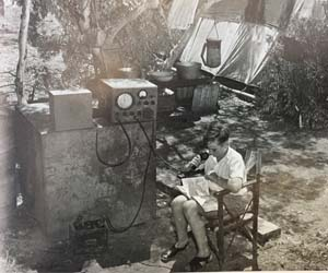 Barry Coles on air at a government contractors' camp, Northern Territory 1960s [Royal Flying Doctor Service donation to CDU Nursing Museum].