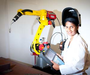 Senior technical officer Hemangi Surti controls the welding robot at NACOG