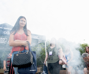 CDU student Eva-Marie Marshall observes a traditional smoking ceremony as O Week begins