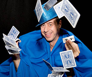 Associate Professor in Psychology Simon Moss incorporates magic shows into his lectures at Charles Darwin University because the challenge makes him happy. Photo: Julianne Osborne