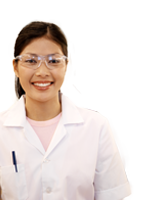 woman in lab coat smiling