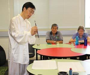 Confucius Institute Chinese Co-Director Mr Donghe Liu conducts a calligraphy demonstration
