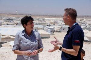 Emma Kettle with RedR Australia electrical engineer John Simpson in front of a section of Za'atari refugee camp