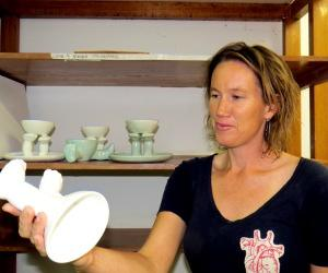 """Mel Darr inspects one of her ceramic pieces included in """"The Some of Us"""" student art exhibition at Araluen Arts Centre."""