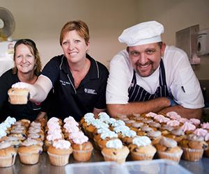 Muffin decorating is one of the many creative workshops at CDU's upcoming Open Day. From left: Tracy Worth and Cassandra and Robert Schwerdt
