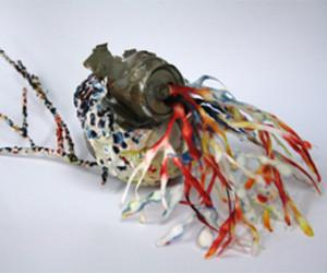 "CDU Visual Arts Lecturer Sarah Pirrie's sculpture ""Return to nature through beer cans"" has been entered into the 2013 Togart Contemporary Art Award."