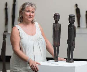 Curator Joanna Barrkman with some of the Sculptures of Atauro Island
